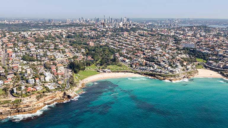 View of Sydney's Easter Suburbs from the east showing Bondi Beach and all the way to Sydney CBD.
