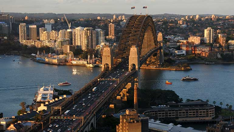 Photo of view from Sydney CBD looking north to the Lower North Shore with the Sydney Harbour Bridge.