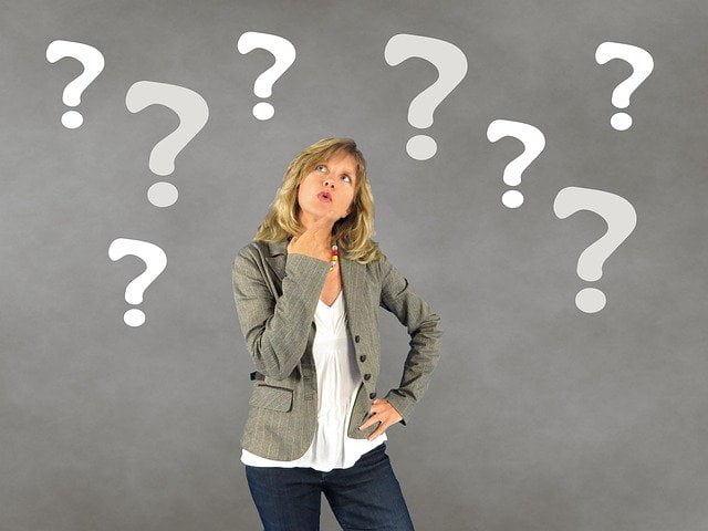 Woman Surrounded with Question Marks