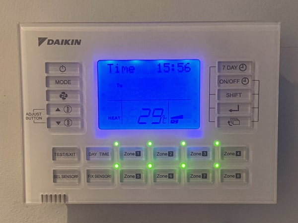 Daikin control panel attached to an interior wall with up to 8 zones.