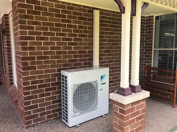 Outdoor unit as part of a Daikin split system air conditioner.