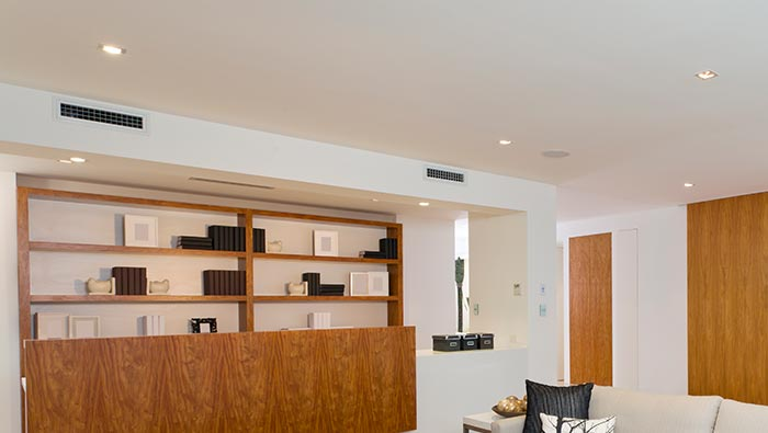 VRV air conditioning system showing vents just below ceiling