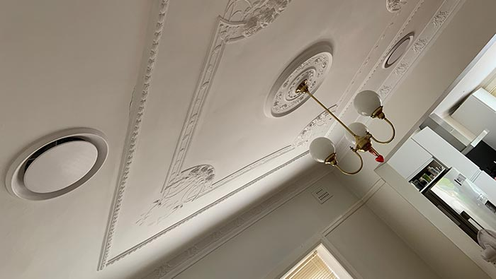 Ceiling with hanging light and vents as part of a ducted air conditioning system