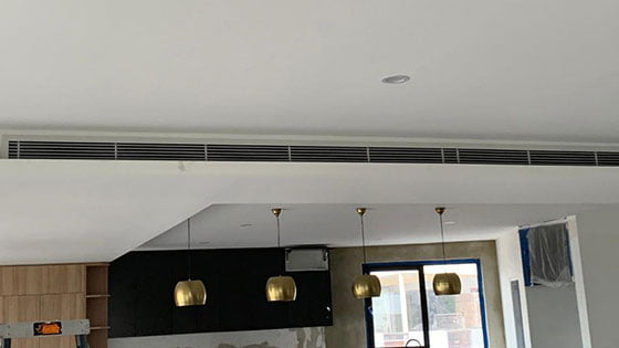 Large vent just below ceiling as part of a VRV / VRF aircon system